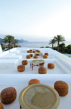 Moroccan brass tea tray tables + poufs looking perfect here....