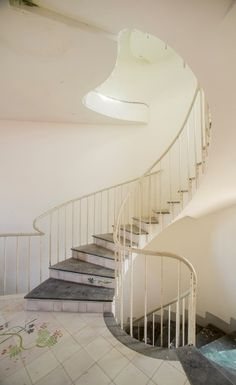 Photographic reportage of La Saracena designed by the architect Luigi Moretti in Santa Marinella (RM). Even if the villa has been documented in a state of . Luigi, Stair Railing, Stairs, Stair Shelves, State Of Decay, Italian Villa, Vestibule, Photo Essay, Christen