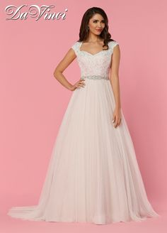 DaVinci Bridal Style # 50456 This soft tulle gown features a queen anne neckline covered in lace with a key-hole back. Beaded trim accents the a-line skirt into a chapel length train.