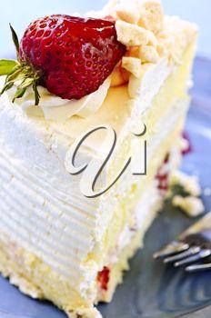 iPHOTOS.com - Slice of strawberry meringue cake on a plate