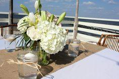 Rustic beach wedding centerpieces - burlap, mason jars, hydrangeas, asiatic lilies, roses, jute; #houseofhydrangeas