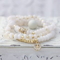 White Jade Stretch Bracelet with Gold Plated Brass Nuggets and Rhinestone Peace Charm, White Bracelet, Trendy Summer Bracelet Bracelet Love, Bracelet Making, Jewelry Making, Gemstone Jewelry, Beaded Jewelry, Jewelry Bracelets, Handmade Jewelry, Summer Bracelets, Bijoux Diy