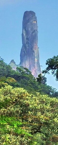 """The Finger of God"" in Teresópolis - Rio de Janeiro. Finger-of-God is a peak at 1692 m altitude at the top, and whose outline resembles a hand pointing the finger at the sky. It is one of several geological monuments of the Organ Mountains, a region understood sector of the Serra do Mar - between the cities of Petropolis, Teresopolis Guapimirim and in the state of Rio de Janeiro, Brazil."