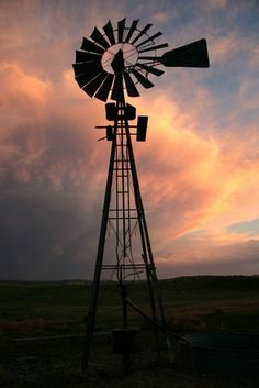 this looks like a windmill from where my grandfather grew up....the house is long gone, but the windmill still stands in the middle of the fields...close to where I grew up.