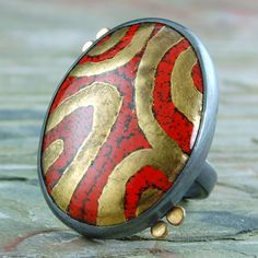 Enamel Ring. Red and 24 Kt Gold Enamel, Sterling Silver, 18 KT Gold. US size 6. $245.00, via Etsy.