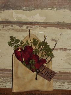 I have tea-stained this envelope and added two of my hearts, primitive floral and berries. On the outside I added a tag that say LOVE with a rustic key.  Nice accent for a counter or grouping. I have added stiffener to make it stand well. Measures approx 6 x 8 high.