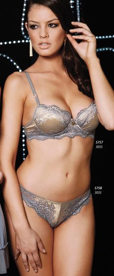 Brazilian Lingerie - Uniquely Sexy Lace Bra and Panty Set. Gisele Lima offers free discreet shipping on all of our Uniquely Sexy lingerie, clothing, plus size, Brazilian imports, bridal, stockings, costumes, gift sets, novelties & more.  Color: Light Blue & gold. Our Brazilian lingerie is carefully designed with ultimate quality materials, achieving not only an exotic and splendid design but also a comfortable fit. MADE IN BRAZIL.