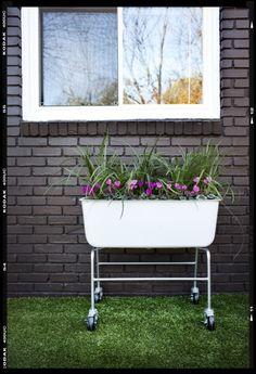 Mobile Garden! Reduce weight by filling the bottom half with plastic bottles with lids on.