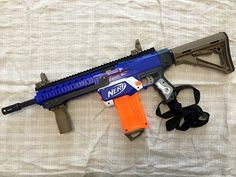 Nerf Gun Games, Arma Nerf, Modified Nerf Guns, Nerf Storage, Cool Nerf Guns, Boy Room Paint, Nerf Mod, 3d House Plans, Toy Cars For Kids