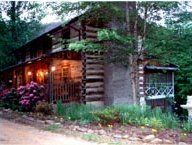 Huckleberry Inn Bed and Breakfast, Sevierville, TN. A beautiful hand-built log inn secluded in the heart of the Great Smoky Mountains near Gatlinburg, Pigeon Forge, National Park, and Dollywood. The Inn features three guest rooms furnished with beautiful hand-carved furniture and antiques, all with private whirlpool bath.