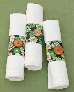 These napkin rings were made from Belgian wallpaper, wooden buttons, and twine