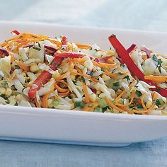 Cabbage and Corn Slaw with Cilantro and Orange Dressing.  Light and refreshing.  Just had this at a local restaurant.  Delish...and easy. ;0)