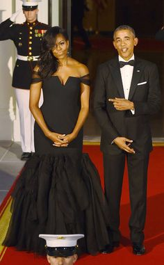 <p>What a dream! FLOTUS turns heads in a midnight blue Monique Lhuillier creation with guipure lace and a textured jacquard skirt.</p>