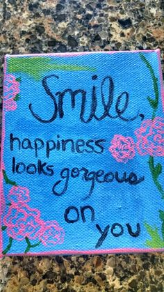Hand painted quote. Smile, happiness looks gorgeous on you.