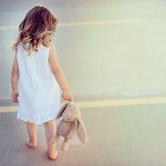 Little girl, white dress, bunny rabbit