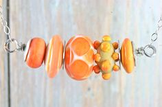 Glass Bead Necklace, Handmade Lampwork Focal in Tangerine, White and Stone w/ Sterling Silver on Etsy, $56.00