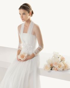 Rosa Clara bridal collection 2013. I love the simplicity of the dress. Elegant.