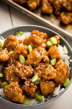 Trader Joe's Mandarin Orange Chicken Rice Bowls: TJ's beloved mandarin orange chicken is one of its most popular products year after year. We turned the Chinese favorite into rice bowls using TJ's frozen rice, sesame, seeds, and scallions.