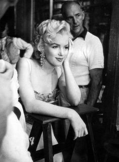 "Marilyn Monroe relaxes between scenes on the set of ""There's No Business Like Show Business"" (1954)"
