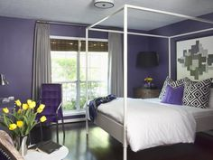 Eggplant purple bedroom with pops of yellow and green