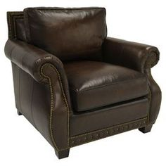 "Add a well-appointed touch to your living room decor with this sophisticated selection.  Product: ChairConstruction Material: Top grain leather and woodColor: BrownFeatures:  Nailhead trimBlendown seatHeavy gauge sinuous springs Dimensions: 35.5"" H x 44"" W x 38.5"" DCleaning and Care: Wipe with soft dry cloth"