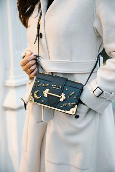Black Tessuto nylon Prada clutch with gold-tone hardware, pleat accents at exterior, black logo jacquard lining and zip closure at top. Shop authentic designer handbags by Prada at The RealReal. Spring Handbags, Cute Handbags, Gucci Handbags, Handbags Michael Kors, Luxury Handbags, Fashion Handbags, Purses And Handbags, Fashion Bags, Leather Handbags