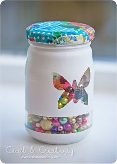 Decorate a jar...great tutorial on covering a lid with paper.