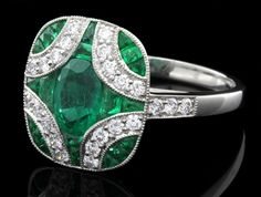 Emerald and diamond antique ring of the day. But I would do amethyst because that's my birthstone.