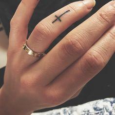 Cross finger tattoo