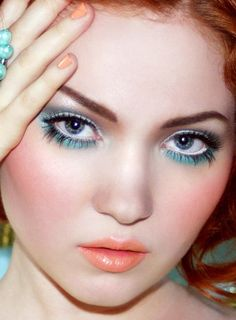 mermaid look with turquoise shadow and coral lips/cheeks/nails