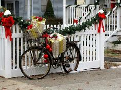 Old bike decorated for christmas with presents in basket...