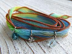 Bracelet silk with steel elements by Charmecharming 13,50