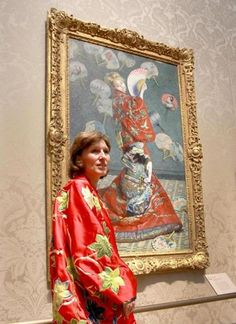 """Sue Danielson of Kentucky, with Monet's """"La Japonaise"""" at the Museum of Fine Arts on June 24. The museum had kimonos for people to try on and pose as Camille Monet did in the painting."""