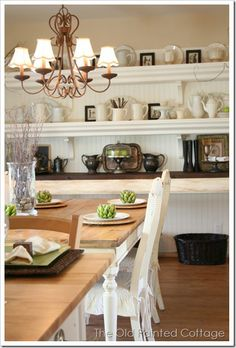 Love the white shelves and the long narrow table (under the shelves) in this dining room.