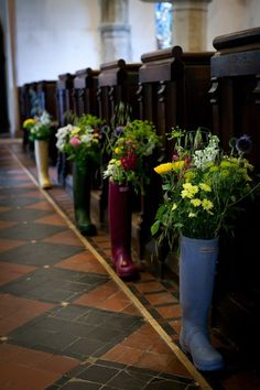 Wedding venue decoration - flowers in wellies. Interesting use for your Hunter Boots!