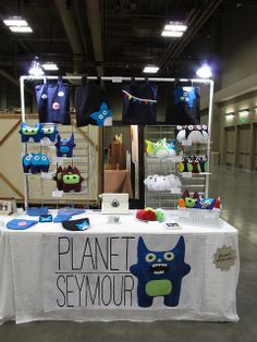 Pvc pipe frame above stall. Austin Craft Riot Summer Show 2012   Flickr - Photo Sharing!