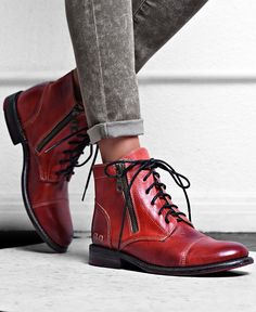 Add a pop of color to your footwear collection with these handmade red leather booties by BEDSTU.