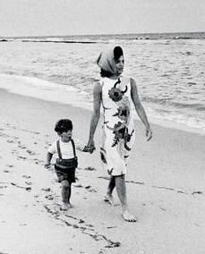 Jackie O and little JFK, Jr. walking on the  beach