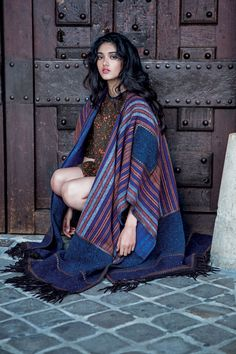 Elle India | Neelam Gill: String Theory | Woollen blouse, Rs 45,400, woollen skirt, Rs 56,740; both Fendi. Woollen blanket cape, Rs 5,58,762, Etro