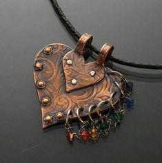 Funky Chakra Heart Pendant, copper pendant, textured by rolling mill, leather collier long. I love copper jewelry and this pendant really caught my eye. Copper Jewelry, Leather Jewelry, Wire Jewelry, Pendant Jewelry, Jewelry Crafts, Jewelry Art, Jewelery, Jewelry Necklaces, Handmade Jewelry