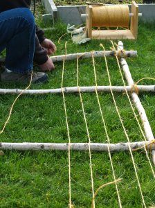 twine trellis for cucumbers or beans make on Inge's side to look pretty and hold up   the climbing roses and grape vine in the summer.