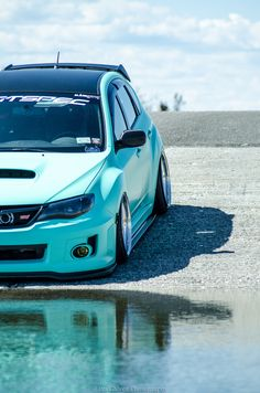 I love the color! I'd put white wheels on it!!  Subaru sti  perfect stance, paint, and wheels
