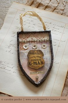 Paper, paint and ink collaged background for a soldered pendent. Made by: Carolyn Peeler