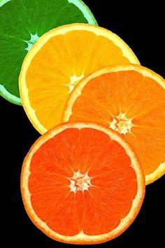 Black background with a lime, lemon, orange, & red (is that another orange? Green And Orange, Orange Color, Orange Art, Fruit Photography, Orange You Glad, Oranges And Lemons, Fruit Art, Limes, World Of Color
