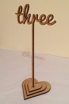 Laser cut thick script name style table numbers - provided blank so you can decorate as you wish. high (width varies depending on number) plus a stake. Wooden Table Numbers, Wooden Tables, Wedding Table Names, Diy Wedding, Wedding Ideas, Wooden Centerpieces, Table Decorations, Laser Cutter Projects, Wood Names