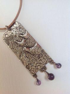 Anna Le Moine Gray's Hamptonne hen silver point made into a pendant