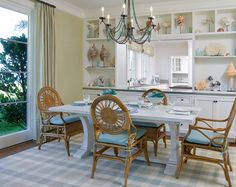 dining room with cut out to kitchen and built in shelves