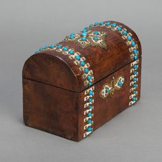 Burled Wood Tea Caddy With Turquoise Beads  --  Circa 1900 English coffer-style tea box in burled walnut embellished with brass and turquoise beads. Original inside tin liners are not present.  --   Item:  220  --  Retail Price:  $895