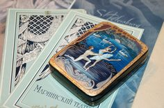 Russian Lacquer Box hand painted in Kholui Art style blue russian box «Swan Lake» This beautiful piece of art was made by hand in Russia. Miniature painting on the box displays the dance couple from Russian National Ballet Swan Lake. Tchaikovsky's first ballet Swan Lake, recognized as one of the best classical ballets of all time.  • Completely Handmade • Hand-painted and signed by Artist Ivanova • Made from papier-mache • Egg tempera • Gold leaf  Size 3.5 x 4.7 x 1.2 inches or (9 x 11.8 x…