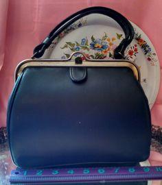 Aunt Bea handbag, available for purchase at https://www.etsy.com/listing/477909411/dark-blue-handbag-pocketbook-ala-aunt?ref=shop_home_active_2